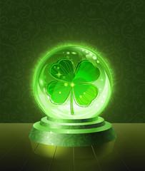 Lucky four-leaf clover inside the crystal scrying ball