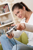 Students - Female teenager playing video game poster