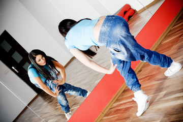 Young girl dancing in the dance club