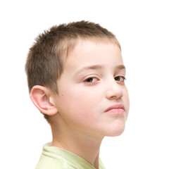 haughty face, little boy poses against white background
