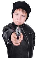 young boy pointing gun, focus on boys face, isolated