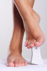 Beauty woman's feet  with a cleaning pumice