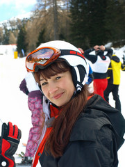 girl in a mountain-skiing helmet