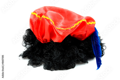 red hat with blue feather and black hair of Zwarte Piet