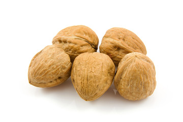 some walnuts over white background