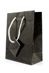 Black paper shopping bag over white background