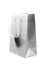 Grey paper shopping bag over white background