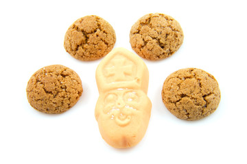 typical dutch sweets, pepernoten over white background