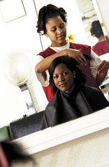 African American woman getting a haircut
