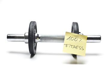 dumbbells with sticked note in front of white background
