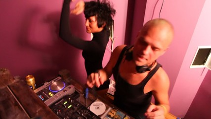 DJ and dancer behind the bar