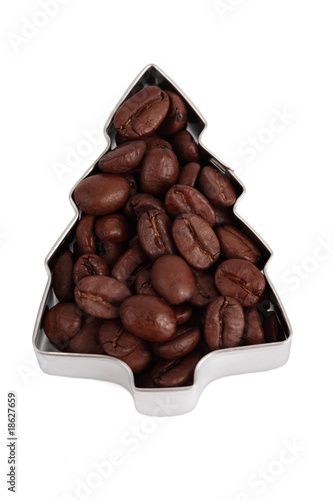 Beans of coffee in the form of Fir Tree close up