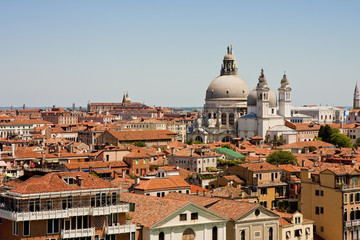 Church Domes Over Red Tile Roofs