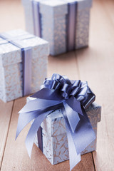 blue gift box with a red tape