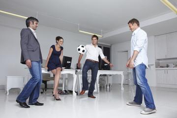 Businessteam plying soccer