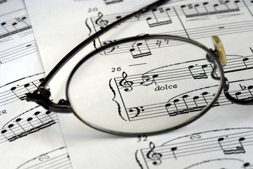 The glasses focus on the music symbols