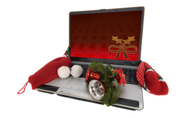 Laptop with christmas decoration isolated in a white background