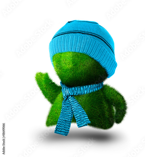 Grass person in sweater and a hat