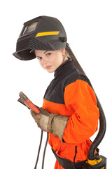 Girl welder worker in welding mask with electrode holder