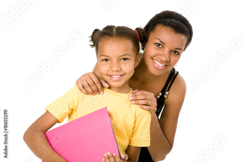 Image of mother touching her daughter and both looking at camera