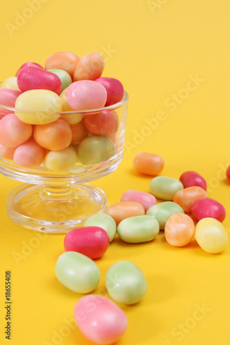 sweet candy on yellow background