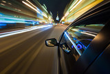 Fototapety Car driving fast in the night city