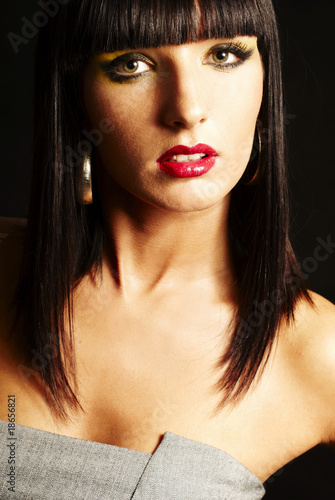brunette woman on dark background - close up, warm lighting