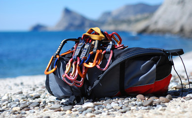 Backpack of the rock-climber with quickdraw