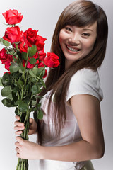 big smile on asian girl with roses