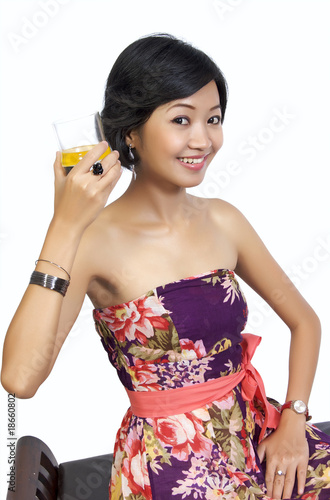 Beautiful Woman Drinking Orange Juice While Sitting