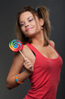 happy funny woman with lollipop