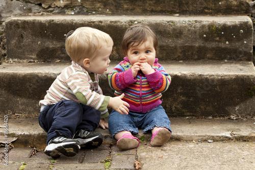 Young  Boy Giving Baby Girl a Hug