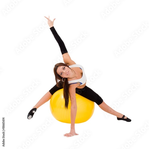 Attractive young woman on a fitness ball