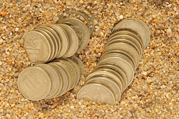 money coins in the sand time is money concept