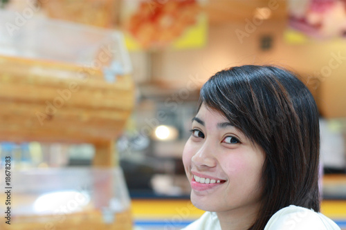 portrait of young asian lady in a restaurant