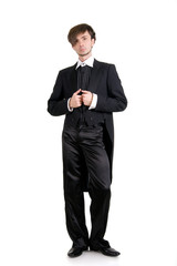A serious young man in a black tailcoat. Isolated.