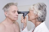 Senior medical practitioner examines man for sight test