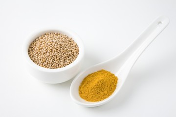 Mustard seeds and turmeric