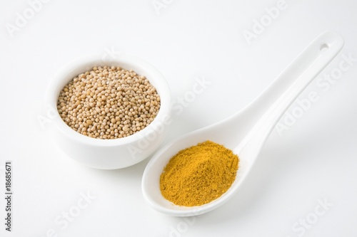 Mustard seeds and turmeric