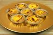 Portuguese egg tarts on golden plate