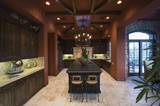 Dark wood and beamed ceilings of Palm Springs kitchen interior