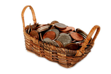 Basket filled with US coins isolated on white.