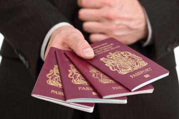 Presenting four British passports at the airport