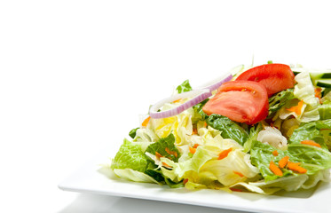 Tossed salad on a plate on a white background