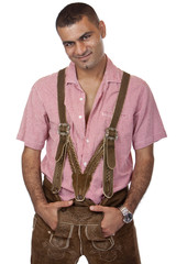 Sexy happy man with Oktoberfest leather trousers (Lederhose)