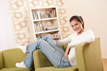 Students - Smiling female teenager watching television
