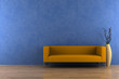 orange sofa and vase with dry wood in front of blue wall