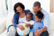 Happy family holding a terrestrial globe
