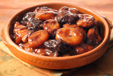Dried fruits in syrup in terracotta dish poster