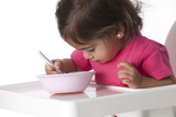 Baby girl is eating by herself poster